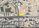 ارض تجاريه على شارع الشيخ خليفه تصريح ارضى و 18 تملك حر بموقع مميز **(OK) QR