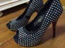 Elegant black high heels 35 aed