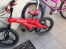 A red bicycle for children's which is in very good condition
