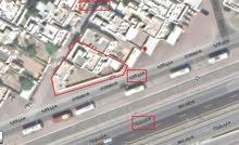 مبنى سكني تجاري بموقع متميز بالخوير للإيجار أو الإستثمار