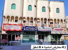 مبنى تجاري للبيع ثلاثة ادوار اول صفة شارع الغبيراء صلالة الجديدة