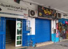 فندق الوحدة العربية شارع عمر المختار بي القرب من الاشارة الضوئية شارع جمال