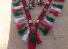 صدريه بألوان علم عمان