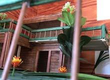بناء مجسّم من خشب لأي بيت