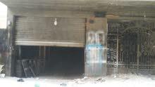 محل به عداد كهرباء للبيع از المشاركة او الايجار بالنزهة 2 قريب من شارع الخمسين