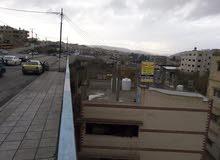 منزل للبيع مكون من طابقين تجاري  واجهة 32 متر ع الشارع