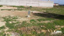 ارض في كرزاز بالقرب من مدرسه بدر الكبري مساحتها 583متر للبيع