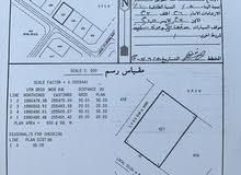 أرض سكنية مربع و خلف مستشفى مرباط ركن الجنوبي موقع
