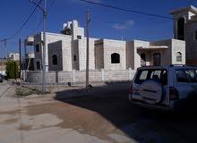 عماره عظم تتكون من طابق تسويه وطابق ارضي جديده اربع واجهات حجر على شارعين