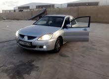 Mitsubishi Lancer car for sale 2005 in Al Karak city