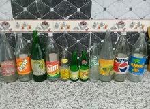 14 قنينة للمشروبات الغازية أنواع مختلفة قديمو وناذرة