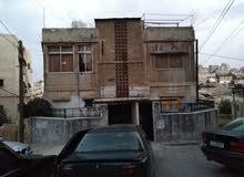عمارة جبل تاج حي الكركية