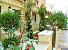 شقة ارضية في خلدا ام السماق180م وحديقة180م