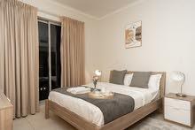 دبي داون تاون غرفة وصالة مفروشة سوبر لوكس مع بلكونة- ايجار شهري شامل