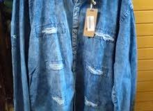 قميص جينز مشقق على الموضة بسعر منخفض