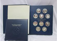 مجلد من 50 عملة فضية 925 لمجموعة كاملة ونادرة تخلد ذكري الالعاب الاولمبية