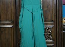 فستان سهرة لون اخضر حشيشي