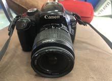كاميرا كانون 1100Dبحاله ممتازه معها شاحن وبطاريه ومومري16