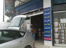 محل مواد بناء للبيع  الزرقاء في شارع الجيش