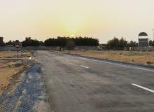 أرض سكنية بأفضل موقع في عجمان قريب على الشارع الرئيسي مباشر .. على شارع اسفلت تصريح G+2 ..