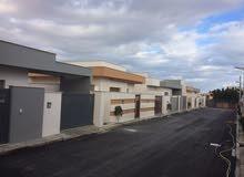 منازل ارضية للبيع في منطقة عين زارة