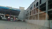 لمحبين الاستثمار مبنى معه محطة بترول في سلطنة عمان