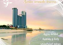 شقة فندقية بأبراج الكورنيش شاطى عجمان فقط مقدم 5%