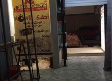 محل في حي الهرم قريب من الشارع الرئسي للايجار