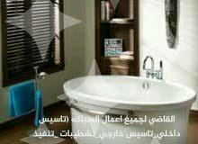 سباك صحي لاعمال صيانة الحمامات