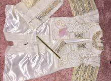 بدلة كبيرة وفضة هندية وكاب للبيع