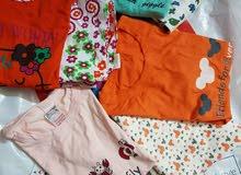 ملابس اولاد وبجامات بنات وفساتين