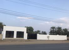 محلات ومخزن للإيجار في ولاية صحم على الشارع العام