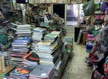 محل مكتبة في العين منطقة اليحر للبيع موقع ممتاز ووسط السوق