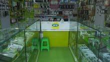 محل تلفونات للبيع ونص في شارع رئيسي وسط صنعاء