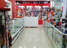 محل تلفونات للبيع في دبي ابوهيل  على باب المترو القيادة بكامل ديكوره والبضائع