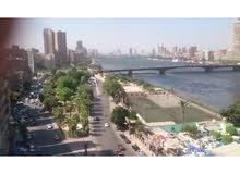 شقه علي النيل في الجيزه موقع متميز جدا خيالي