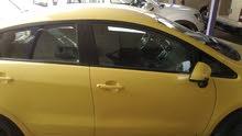 Yellow Kia Rio 2014 for sale