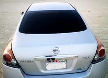 Nissan Altima for sale 2012 model silver color Excellent Condition