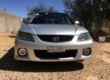 Mazda 323 made in 2003 for sale