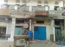 باب مشرف السوق القديم الحديده عماره تجاريه