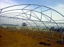 بيوت زراعية  محمية greenhou ري تنقيط هياكل معدنية، ري محوري ،بناء هنجر هناجر