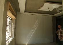 شقة للبيع بالأقساط ارضي امامي يمين مساحة 125م مع ترس بضاحية الحج حسن