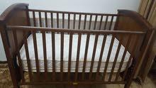 سرير اطفال خشبي من جونيورز