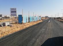 للبيع اراضي تجاري سكني بعجمان على طريق الشيخ محمد بن زايد مباشرة
