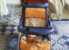 عربة اطفال ذو مقعدين