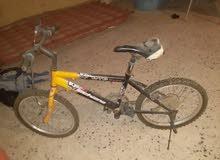 دراجة 20 حاجة مليحة  100دينار بس