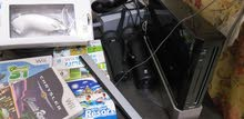 Wii + 4 CD + جهازين تحكم + قطع غيار (قابل للتفاوض)