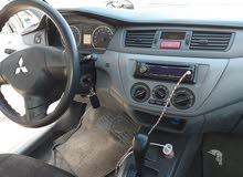 لانسر 2012 لون ابيض فحص 7 جيد موتور 1300