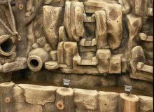 عشب صناعي وتنسيق الحدائق والأعمال الفنية