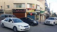 مبنى و مخازن تجارية للإيجار في عمان